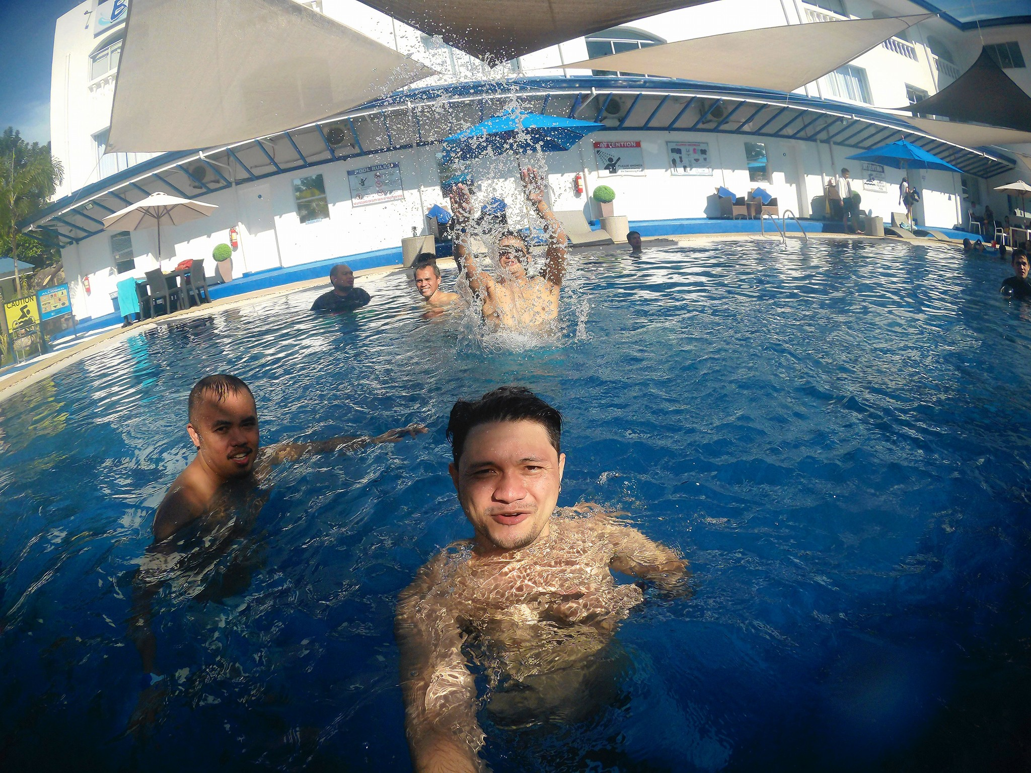 Innovuze employees having fun in the Blu Sands Resort's swimming pool